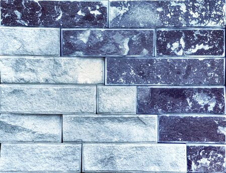 Stone wall, multicolored sandstone in the form of a tile, background or texture.