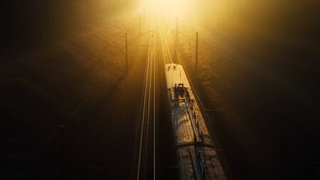 The train moves from darkness towards sunset, movement to light, concept