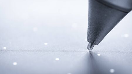 Black pen on graphic tablet surface, closeup. The work of an artist or illustrator.
