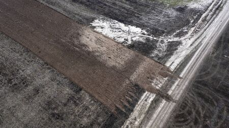 Soil erosion, sand penetrates through the black soil. 版權商用圖片