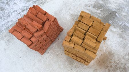 Two pallets of brick, on concrete surface, construction, concept, background with place for text.