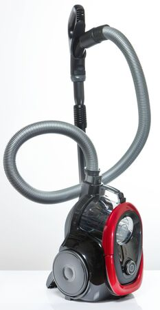 Black and red vacuum cleaner with container without hoses on a white background