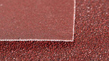 Macro texture of red abrasive material, sandpaper.
