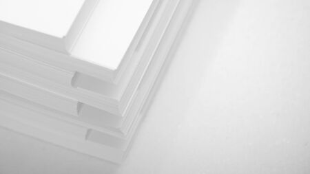 Abstract background, minimalism. Several stacks of white paper for photocopier, on a white background. Office work concept.