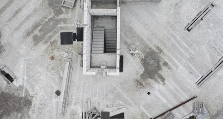 Background or texture of reinforced concrete structures. Top view of an abandoned construction site.