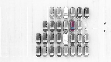 Drone view, new car parking, near the car dealers logistics center. The parking lot of the updated lineup of cars near the auto shop.