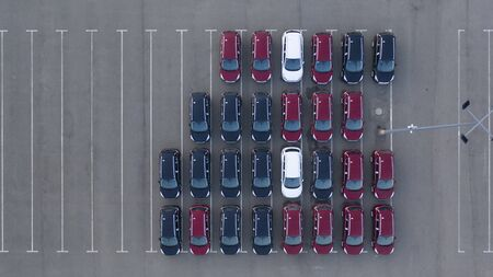 Drone view, new car parking, near the car dealer's logistics center. The parking lot of the updated lineup of cars near the auto shop. Reklamní fotografie