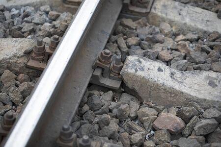 Damaged rail. Reinforced concrete support broke. 版權商用圖片