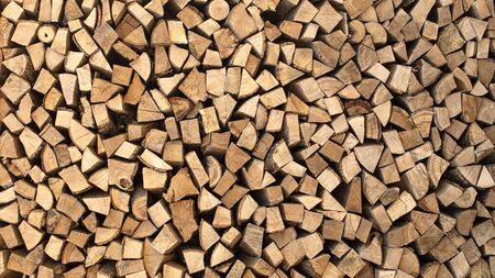 Texture, chopped firewood from different species of trees. Firewood For barbecue.