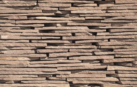 Natural slate background or texture, stone facing tile, for facade work and for interior design.