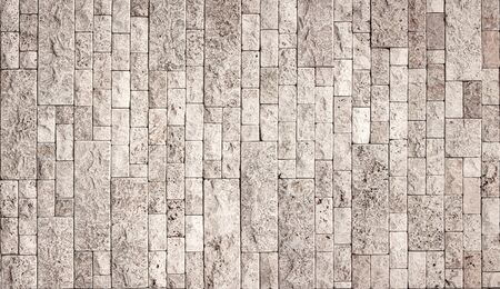 Stone wall texture, square yellow travertine tile. Design element or background.