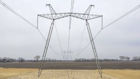 Metal supports of power lines passing through agricultural fields.