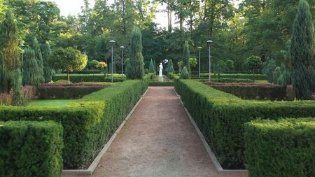 Central park of Bucha city, Kyiv region. Furnished in French style. Using topiary forms, and hedges of coniferous and deciduous shrubs. Great place to relax.