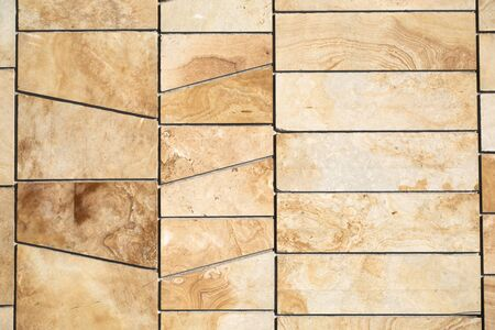 High quality wall texture made of natural stone, sandstone. Background for design. Natural building material for interior and exterior decoration.
