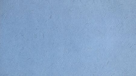 Texture of sky blue cardboard with embossing, for bindings or business cards.