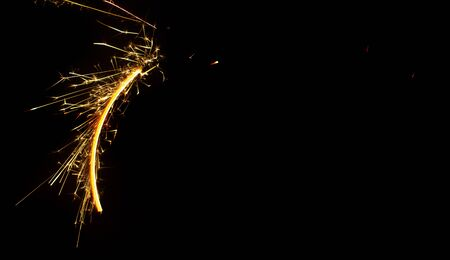 Perfectly even circle, painted with sparklers on black background, closeup. The number is zero.