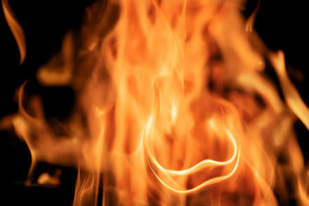 High quality texture of fire, flame or explosion on black background. Close-up
