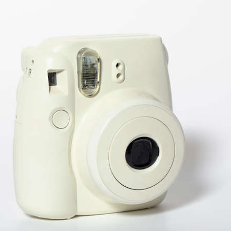Old white plastic camera, 80s on a white background.