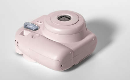 Old pink plastic camera, 80s on a white background.
