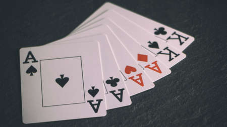 Four of a kind poker hand on a black background