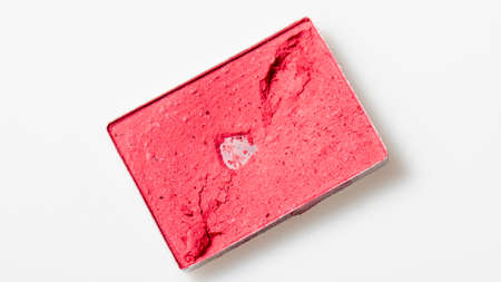 Red cosmetic powder square shape on a white background, material for makeup.