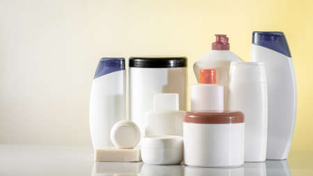 Banner Hair and body care cosmetics white bottles on white background Copy space selective focus close up