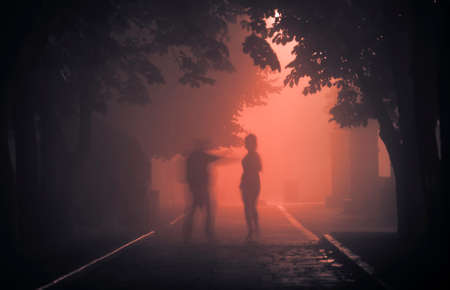 A maniac on a foggy street at night attacks a passerby.