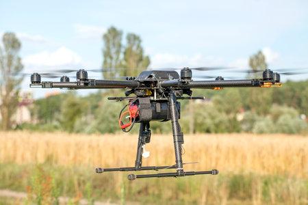 Big black homemade eight motor hexacopter on sky background. 免版税图像