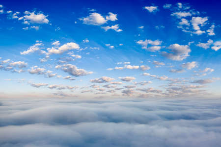 Bright blue sky with white clouds. Panorama. Natural background.