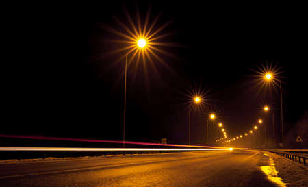 Night free highway outside the city. Photo in long exposure. Top view.