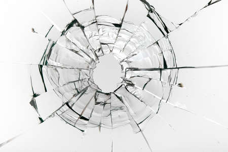 Cracks on the glass on a white background. Broken window.