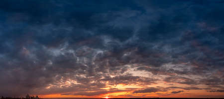 Sunrise or sunset after a thunderstorm, bright panorama of dramatic sky