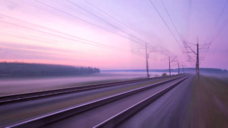 Fast movement over the railway line. Concept, rail delivery, travel and speed. Empty railway at dawn or sunset.