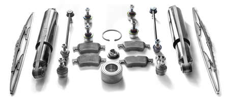 Set for repair of a brake suspension bracket and washing of glass. Hub bearing, hydraulic rack, brake pads, front and rear stabilizer bars on a white background.