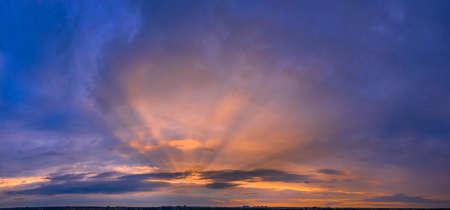 Dawn sky, sunbeams and dreams, morning panorama.