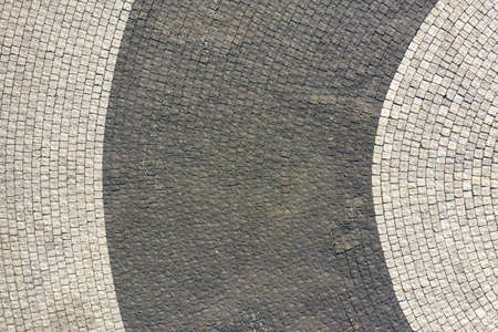 Paving vintage tiles for the backyard, top view texture.