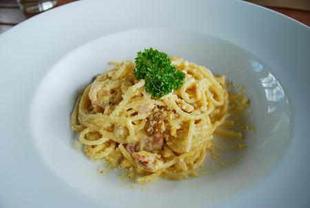 Spaghetti Carbonara in the white dish photo