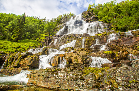 waterfall with sky: Waterfall Tvindefossen is the largest and highest waterfall of Norway, it is famous for its beauty, its height is 152 m.