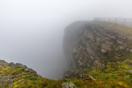 North Cape (Nordkapp), on the northern coast of the island of Mageroya in Finnmark, Northern Norway on heavy foggy day.