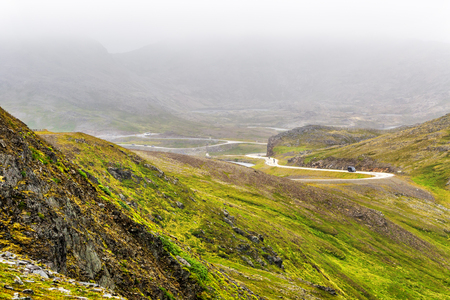 Beautiful road goes through norwegian mountains  in Troms country, Norway. Stock Photo