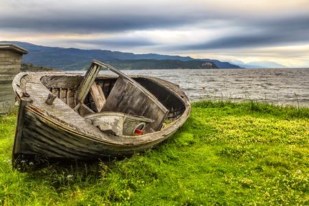 Old fishing boat and beautiful sunset on Jiepmaluokta bay  in Norway. Reklamní fotografie