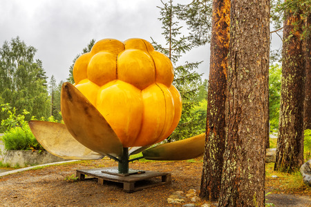 RAUNA, FINLAND - JULY 07, 2016: Ranua Wildlife Park. Cloudberry monument. At the park you can see polar bears, as well as 50 different other arctic animal species in the midst of northern woods.