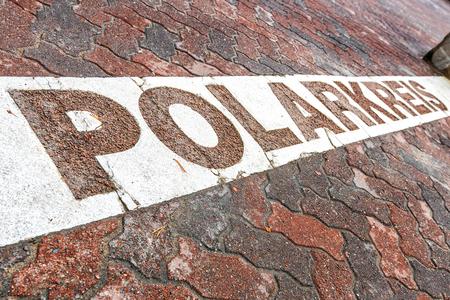 Line of the arctic circle in Rovaniemi, Finland. Translation - Polarkreis  - Polar circle. Reklamní fotografie