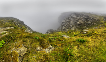 North Cape (Nordkapp), on the northern coast of the island of Mageroya in Finnmark, Northern Norway on heavy foggy day .