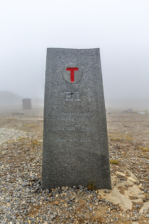 Waymarking  of international hikig trail E1- North Cape (Norway) - Castellucio (Italy). Approximately 7000 km long trail leading from north to south. Placed on North Cape (Nordkapp).