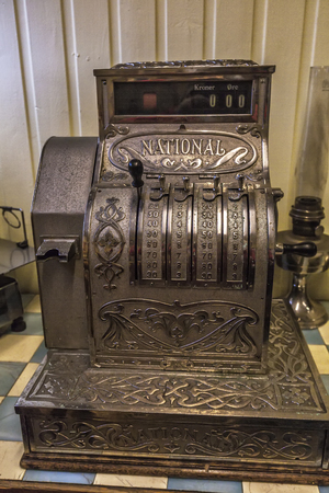 Vintage old metal cash register close-up