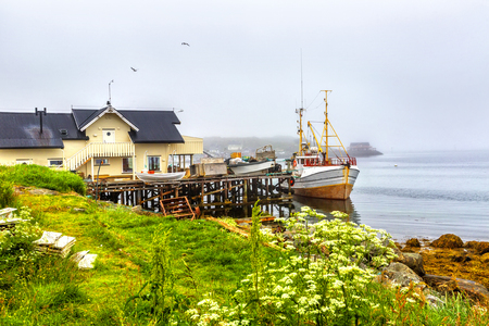 Small traditional fishing boat stands moored in Northern Norway.