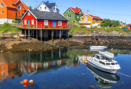 Scenic view of Colorful wooden buildings in Henningsvaer in summer. Henningsvaer is a fishing village and tourist town located on Austvagoya in the Lofoten Islands. Norway. Reklamní fotografie