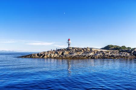 Lighthouse on the Trollfjord (Trollfjorden) in the Lofoten Islands, Norway.