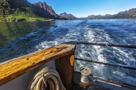 Trail  behind of the ship on water surface on Trollfjord (Trollfjorden) in the Lofoten Islands, Norway.